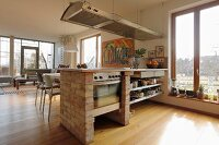 Kitchen counter with brick side walls in open-plan interior