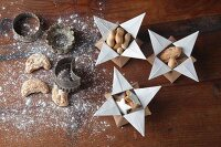 Christmas biscuits in origami star-shaped gift boxes