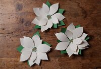 Hand-crafted paper flowers as Christmas decorations