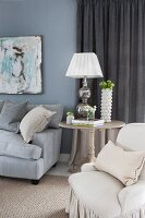 Upholstered furniture and table lamp on side table in living room