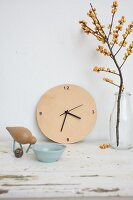 Wall clock with leather face, wooden bird and bowl