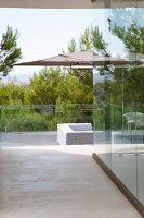 Terrace with glass balustrade and view of landscape
