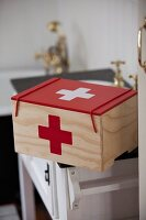 First aid box painted with red cross