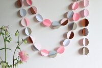 Hand-crafted garland of stamped paper circles