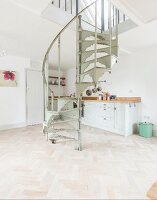 Vintage spiral staircase in kitchen-dining room with herringbone parquet