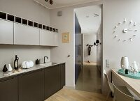 Dining table and delicate animal figurines in kitchen integrated unobtrusively into living area