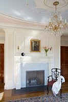 Grand interior with fireplace, chandelier and stucco ceiling rose
