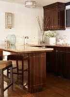 Glossy, brown, country-house kitchen with counter in elegant interior