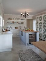 Open-plan kitchen with free-standing, country-house-style island counter