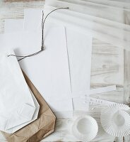 Paper bags, paper cake cases and white paper sheets for crafting Christmas decorations