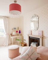 Classic furnishings in child's bedroom with desk, pouffe and fireplace