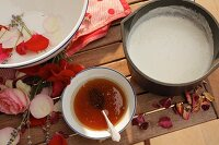Ingredients for milk bath: milk, honey and rose petals