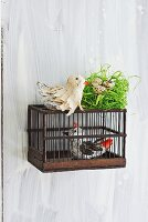 Bird ornaments hand-crafted from tin foil and paper strips as spring decoration