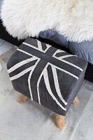 Stool upholstered in grey and white Union Flag