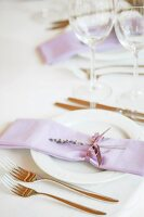 Lilac line napkin with sprig of lavender on festive place setting