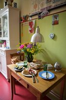 Set breakfast table in kitchen-dining room of period apartment