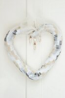 Heart-shaped wreath made of chiffon ribbon with pearl drop beads as wedding decoration