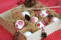 Polystyrene baubles festively decorated using napkin decoupage