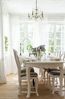 Set table in dining room with Gustavian-style furniture