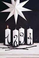 Candles decorated for the four Advent Sundays
