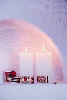 Rectangular candles decorated with boxes of matches