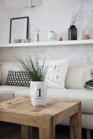 Ornamental grass in hand-made printed paper bag on rustic wooden table