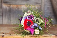 Bouquet of anemones and bilberry stems