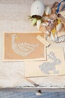Cards embroidered with Easter motifs on vintage surface