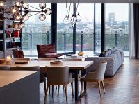 Open-plan living area with glass wall and view of London