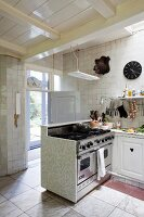 Counter and hunting trophies in open-plan kitchen