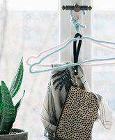 Wire clothes hangers with knitted covers