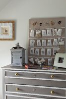Advent calender hand-made from numbered bags on top of grey chest of drawers