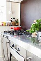 Has hob integrated in stainless steel kitchen worksurface