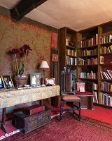 Antique chair with turned legs in front of bookcase in grand library