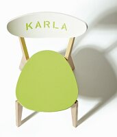 Wooden chair revamped with green-painted seat and lettering