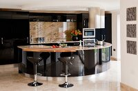 Black glossy kitchen with semicircular designer counter