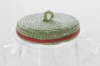 Crocheted lid soaked in glue and fixed onto glass jar covered in cling film with rubber band for shaping