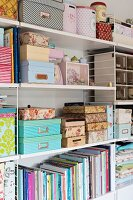 Various storage boxes and books on String shelves