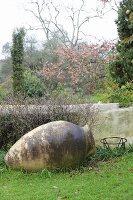 Rustic amphora in autumnal garden