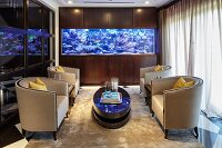 Four armchairs and large aquarium in classic lounge