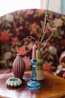 Colourful vases and profiled candlestick
