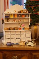 Old-fashioned Christmas toys: antique play shop with miniature groceries