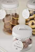 Biscuits and pralines in glass jars
