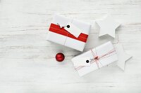 Gifts wrapped in red and white with tags and two stars