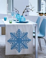 White runner with ice-blue appliqué snowflake motif