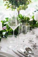 Empty wine and water glasses on table set for Christmas dinner
