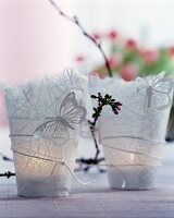 Rice paper tealight holders decorated with butterflies and sprig of flower buds