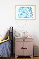 Lilac cabinet used as bedside table in child's bedroom
