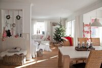 Christmas tree and Advent centrepiece in open-plan living area with Scandinavian ambiance