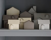 Paper models of houses on shelf